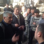 Talking with migrants in the former factory Zil